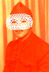 Vintage portrait of a man with a white crochet mask that covers the face.