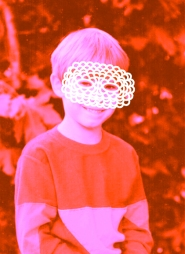 Vintage portrait of a smiling kid with a white crochet mask that covers the face.