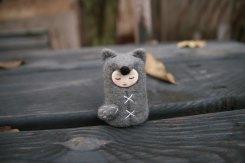 Tiny handmade felt doll.