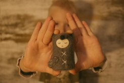 Tiny handmade felt doll.