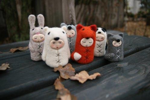Group of six Tiny handmade felt dolls.