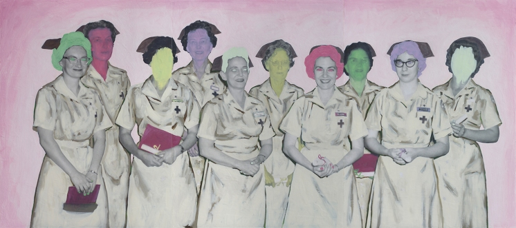 Group of nurses posing in front of the camera.