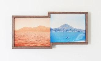 A couple of framed vintage landscape photos.