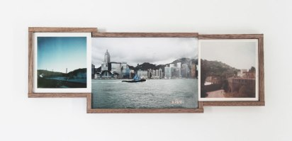 Piscture of three framed vintage landscape photos.