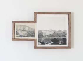 Picture of a couple of framed vintage landscape photos.
