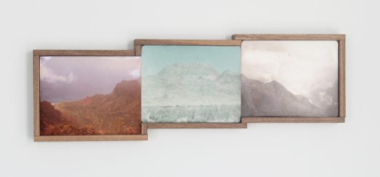 Picture of three framed vintage landscape photos.