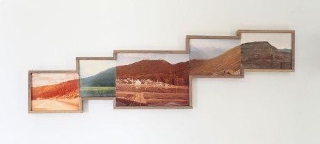 Picture of 5 framed vintage landscape photos.