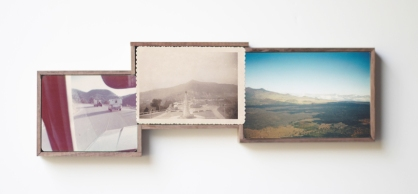 Picture of three framed vintage landscape photos on the wall.