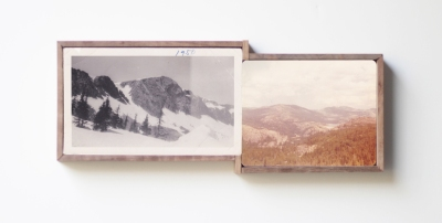 Picture of a couple of vintage landscape photos on the wall.