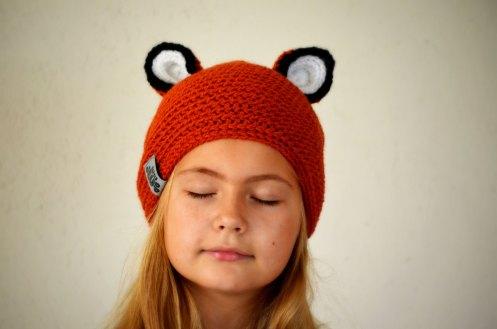 Baby girl portrait wearing a cute fox hat.
