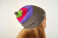 Baby girl wearing a knitted colorful hat.