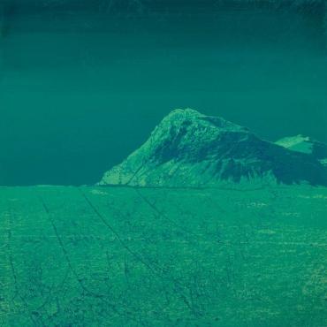 Blue monochromatic landscape picture of a mountain