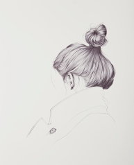 Woman drawing seen from her back.
