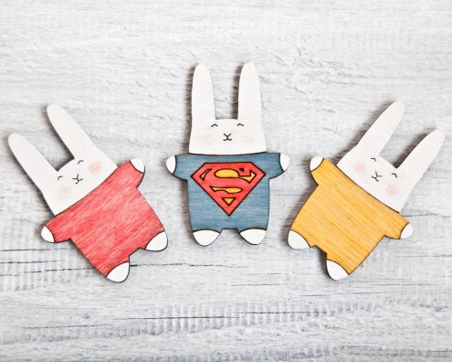 Still life photo of 3 fridge bunny shaped magnets.
