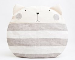 Still life photo of a cat shaped stripes pillow.