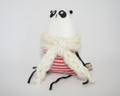 Still life picture of a panda soft toy with a white scarf and white and red striped shirt.