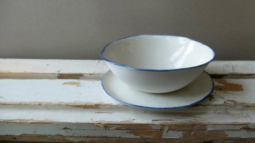 Still like picture of two ceramic plates.