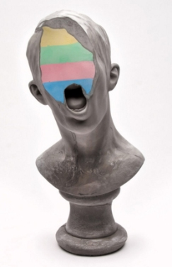 Photo of a defaced bust.