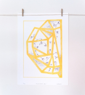 Still life photo of an abstract yellow illustration hang on a wall.