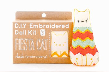 Still like photo of an embroidery kit to create a fiesta cat.