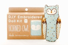 Still like photo of an embroidery kit to create an owl.