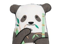 Still life photo of a panda plush toy, frontal view.