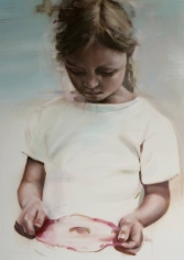 Little girl painting that is observing an object on her hands.