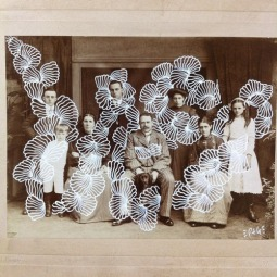 Picture of a vintage group photo decorated with white pen.