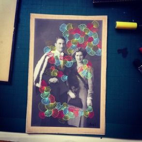 Picture of a vintage photo of a couple decorated with pens.
