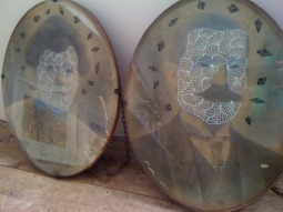 Picture of two vintage oval portrait photos of a man and a woman decorated with pens.