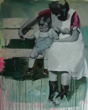 Portrait of a woman with a little boy sat on a bench.