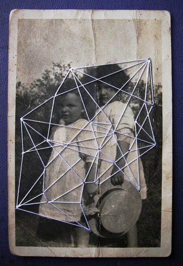Vintage photo of a couple of kids sewed with a white thread.