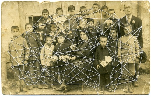 Vintage group photo stitched with white thread.