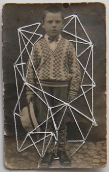 Vintage boy portrait stitched with shite thread.