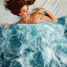 Surreal collage of a woman in bed that holds a duvet cover made of water.