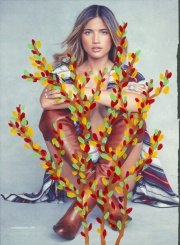 Fashion advertising, woman portrait decorated with multi color floral decorations.