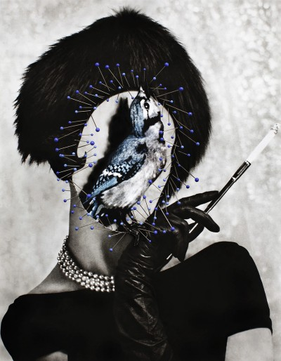 Vintage fashion woman portrait holding a cigarette wih a bird in her face decorated with blue pin needles.