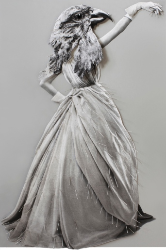Vintage fashion woman portrait with a bird head.