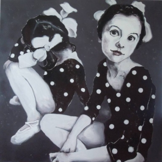 Portrait of two little girls wearing a dotty dance body.