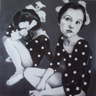 Portrait of two little girls wearing a dotty dance body.