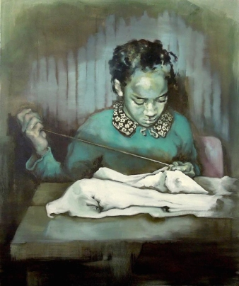 Portrait of a young girl hand sewing on a table.