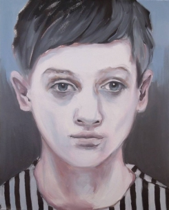 Portrait of a young boy dressing a striped shirt.