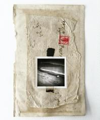 Collage of a squared photo putted over vintage old papers.