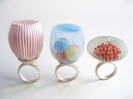 Still life photo of a group of three rings realised with semi transparent and translucent textiles, the shape reminds natural and organic forms taken from nature.