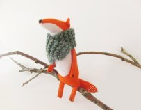 Still life photo of a Felt Fox With Knitted Scarf.