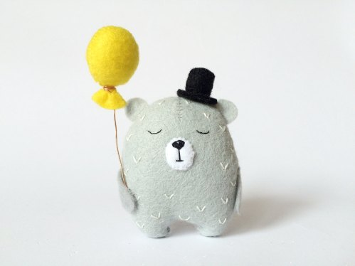 Still life photo of a Grey Felt Bear With Yellow Baloon