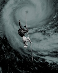Collage of an upside down woman on a rope that is coming down from a giant sky spiral.