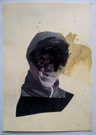 Collage on paper of a man head decorated with black acrylics and coffee.