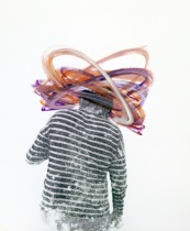 Woman portrait with the face covered with purple acrylic stripes.