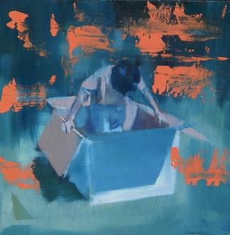Portrait of a little boy inside a giant box.